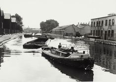 "Caption: ""Train of barges at Old Ford on the River Lee"""
