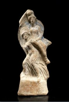 Greek games, Ephedrismos, Greek terracotta ephedrismos group, 4th-3rd century B.C. Showing two piggy back girls, playing the game of ephedrismos, the upper figure holding a discus, with pigment remaining, 18 cm high. Private collection
