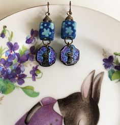 Joan Miller of Joan Miller Porcelain is the amazing talent behind these sweet little bunnies. Sweet Buns, Copper Accents, Big Design, How To Make Earrings, Handmade Jewelry, Hand Painted, Drop Earrings, Beads, Pendant