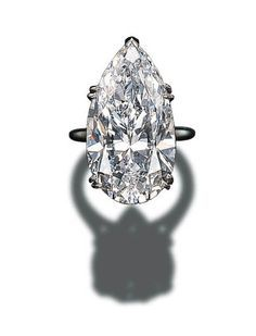 AN IMPORTANT SINGLE-STONE DIAMOND RING, BY CARTIER Set with a pear-shaped diamond weighing 30.70 carats to the platinum hoop Mounted by Cartier, no. T02371 With certificate 11055019 dated 1/3/2000 from the Gemological Institute of America stating that the diamond is D colour, internally flawless clarity 30.70 carats