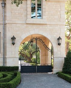 Gorgeous Driveway Gate technique Dallas Traditional Landscape Remodeling ideas with arch archway boxwood brick pathway bushes carport driveway driveway gates French french formal French