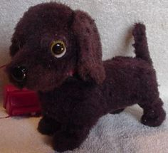1960's remote control puppy - I had one exactly like this! He would walk, wag his tail, and bark. I loved him!