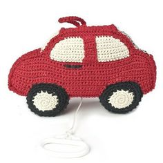 hand crochet musical car from fair trade organic cotton http://www.littlebou.co.uk/anne-claire-petit-crochet-musical-car-red?category_id=292