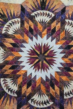 A close up on the Prairie Star Quilting in the Center!  Lots of great little details in the quilting on this project.
