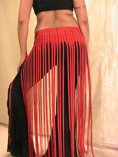 This is a pull on fringed belt made of a red with black pinstriped textured Lycra cut into half inch strips.