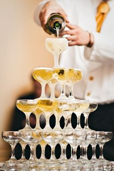 Toast with old-fashioned champagne coupes instead of flutes. | 21 Fun Ways To Have A Fancy And Delicious New Year's Eve