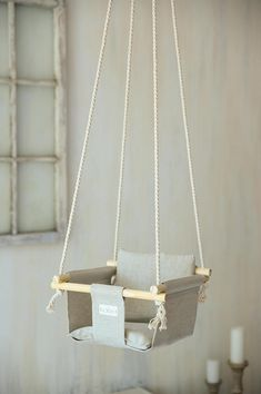 A baby swing / toddler swing in 3 variations of color: gray, white and black. Comes with an extended pillow that covers bottom and back. Swing is made of ecological linen-cotton mix fabric. If You would like to mix thing up- ex. add a white pillow to a gray swing, them PM. Suitable for:
