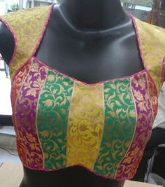 Multicolored Zardozi Blouse - Party wear blouse that can be teamed with Golden / Black / Magenta / Green Saree or Indian Skirts. This is an anokherang creation - for complete collection logon to www.anokherang.com.