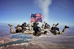 """Marines release the ashes of Marine Corps Sgt. Brett Jaffe above Phillips Drop Zone on Yuma Proving Grounds, Ariz., July 26, 2012. """"It was an honor and privilege to take this Marine on his last jump and give him a proper hail and farewell,"""" said Marine Corps Staff Sgt. Marty Rhett. The Marines are military free fall instructors assigned to Marine Detachment, Fort Bragg, N.C.  U.S. Marine Corps photo by Staff Sgt. Johnny Gunn"""