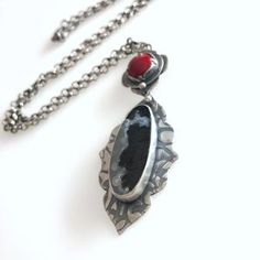 Marfa Agate along with a pop of red enamel in this necklace.