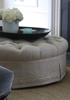 tufted Otto with Greek Key tape- i have always loved this idea for a coffee table with a tray