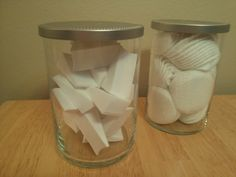Re-use the glass containers from old Yankee Candle Jars for storing bathroom supplies like sponges and makeup pads.  Fill a large pot with water, sit the candle with leftover wax in the water, and boil the water.  The wax should melt and you can pour the wax out into a plastic grocery bag.  Use a butter knife to dislodge the wicks from the bottom of the jar, and use Dawn dish soap to remove excess glue/wax from the jar.  You can also peel off the candle label after boiling the jar in water.