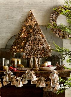 Driftwood slice tree | wreath. Slices of reclaimed driftwood gather for holiday festivities in tree and wreath forms.