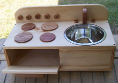 "Adorable Little Kitchen: Small enough to be portable. Made of wood. 24"" L x 11.5"" w x 11.5"" H (back ). $65.  