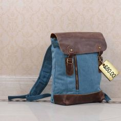 Lookety look! A pretty canvas leather backpack! If there's one thing that annoys me in the summer, it's having to carry a handbag – you need a bag with you, but when you're out and about adventuring, you want your hands free, don't you? but backpacks are inherently ugly, so I usually make do …