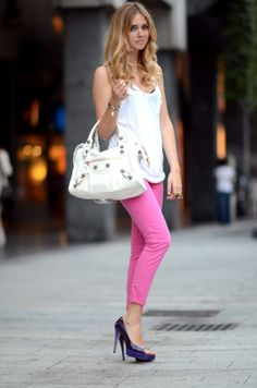 Pink cropped jeans with blue shoes and white top.