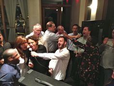 I can see that they are really having so much fun with their karaoke night!