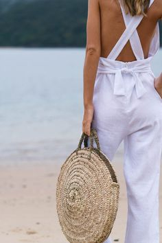 """Perfect for those early morning market strolls... *Ethical and eco-friendly alternative to plastic bags *Handwoven in Morocco *Made from wild palm """"doumdoum"""" Height: 38 cm Width: 38 cm Length: 38 cm Handles: 25 cm (woven sisal handle)"""
