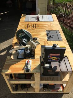 """Mega Ultimate Workbench"". I wanted to save space in my garage by making 1 bench to replace 6 separate tables that held the following items; table saw, router table, band saw, sanders, work table, & miter saw. The measurements are 8' long, 4' wide, & 40"" tall. I used 4x4's as the long base with dados cut in to hold the 2x4 cross sections. The wheels are 6"" iron casters from Menards. #Mega Ultimate Workbench"