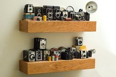 Cherry Wood Floating Shelf by BSWoodworks on Etsy to display my vintage camera collection.
