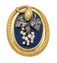 Victorian Diamond, Enamel, Seed Pearl, Silver and 18K Gold Brooch. The oval openwork frame fashioned as a snake with textured scales and tiny ruby eyes, surrounding a plaque with translucent cobalt blue enamel on a guilloché ground, embellished by seed pearl grapes and rose-cut diamond leaves, mounted in silver and 18k gold, mid 19th century.