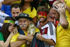 Redditors found the touching moment when a Brazilian fan handed over his World Cup trophy to Germany's fans after Tuesday's match.