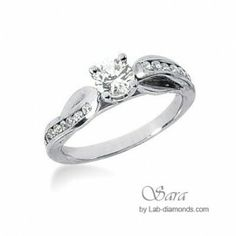 This is the Ventura engagement ring with a doubler swirl shank to enhance the main center stone and accented with small stones set in the shank. #engagementrings #singlerowrings