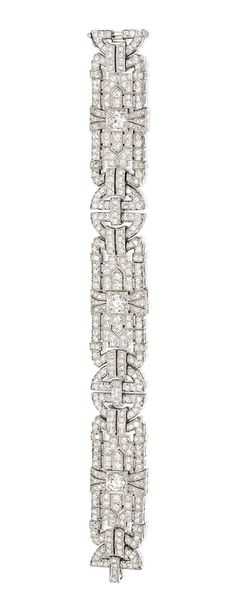 PLATINUM AND DIAMOND BRACELET, CIRCA The articulated bracelet of geometric design set with numerous round and old European-cut diamonds weighing approximately carats, length 7 inches, signed S-E. Art Deco Ring, Art Deco Diamond, Art Deco Jewelry, Fine Jewelry, Diamond Bracelets, Sterling Silver Bracelets, Bangle Bracelets, Diamond Jewelry, Or Antique