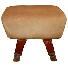 Pommel horse bench. This piece is covered in brushed leather and has pitch pine legs. It stands 24 inches high so will make a perfect bench. The manufacturer is Neils Larsen of Leeds, England circa 1960.