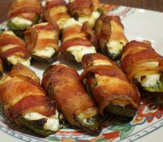 Grilled Jalapeño Poppers!!  Okay, I didn't grill them, but they were AWESOME!!  I added chopped scallions to the cream cheese, and boiled the halved, pitted jalapeños for about 5 minutes to soften them and take a bit of the edge off the spice.  I baked them on a cooling rack placed on a baking sheet to allow the bacon to get crisp all around.  I put them in a 400 degree oven for about 25 minutes (just keep an eye on them and pull them out when the bacon is crisp).  SO YUMMY!!!