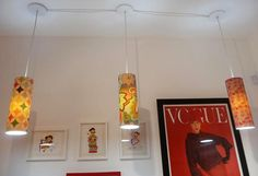 Light fixtures made out of pieces of PVC pipe, covered in Fabric using a standard light kit (like you can buy at Ikea)