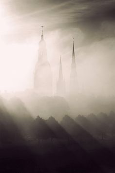 #Towers of old Riga - the #fog and clouds in this image are amazing. And there's just enough lighting to see the twoers. Very cool!