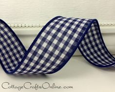 """Navy blue and white gingham check, 1 3/8"""" wide, with a wired edge covered in navy thread. Made of cotton in the USA, the fabric is heavier than our other ginghams, with a closer weave and a denser thread covering over the wire edge. Available from the Cottage Crafts Online shop on Etsy, where we help your ideas become creations. Cottage Crafts, Navy Blue, Blue And White, Craft Online, Christmas Ribbon, Gingham Check, Wired Ribbon, Closer, Weave"""