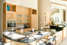Natural Beech Wood cabinets by Peppertree Kitchen and Bath