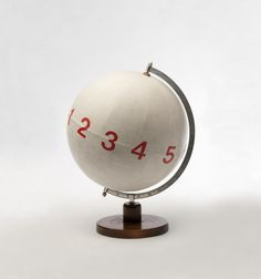 MANGELOS [DIMITRIJE BAŠIČEVIĆ] (1921-1987) Numberconcept Pitagoras c. 1977-1978 plastic letters, acrylic on globe made from wood, metal and paper 18 1/2 x diameter 14 1/4 inches