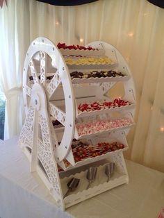 I loooove this!! #candybuffet #wedding - ADD diy <3 <3 www.customweddingprintables.com ...ferris wheel sweet buffet