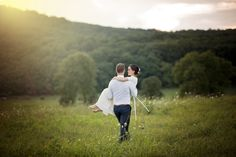 Sunset portraits of bride and groom in a field at summer barn wedding in Maryland