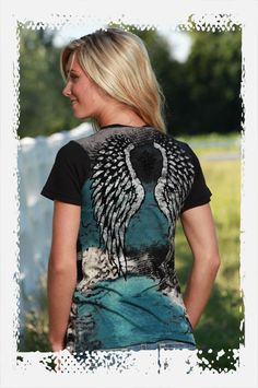 Cowgirl Tuff Company    Black/turquoise/gray jersey tee. Words on front with crystals and large velvet wings on back in black.