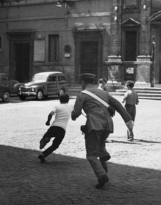 Italy. Police chasing street-child, Rome, 1963 // by Kees Scherer (Dutch,1920 - 1993)