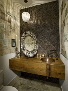 Great use of space in powder bath, mix of rustic and modern, asymmetrical mirror placement, awesome lighting