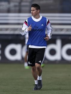 James Rodriguez of Real Madrid warms up during a training session at Valdebebas training ground on March 25 2015 in Madrid Spain