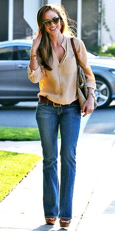 MINKA KELLYEven far away from her maybe-beau in Beverly Hills, the actress looks flirty and fun in a button-up tan blouse, flared jeans and wedges