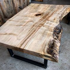 Figured Ambrosia maple live edge coffee table. This was a stunning piece of live edge perfectly sized for a coffee stable. We carefully sanded and clear coated it and put it on raw steel U legs.