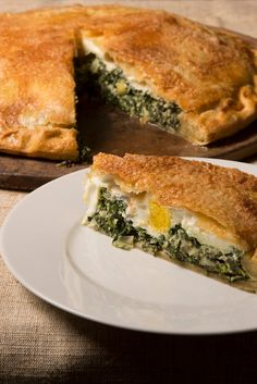 NYT Cooking: This savory pie, called torta pasqualina in Italy, is many times made for special occasions because the preparation is a bit fiddly. The finished product, though, is impressive to behold, and you're sure to draw compliments from your dining companions. Traditional cooks use a strudel-like pastry, rolled out very thin into a large circle, for the pie. At least four layers a...