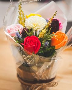 """- 5 roses & 1 carnation soap flowers assorted color flowers. - Measures appoximately 11 1/2""""(27cm) tall (4""""(10cm) tall vase only) - Includes at least 2 different Bushes and Bushes will vary - ITEM # : M1620 - Price : $40 (Reg $45) - Delivery : fee not included email us for detail of delivery #www.keziaherez.com #Order keziaherez@gmail.com #mother's day gift #happybirthday gift #valentinesday gift #soapflower #love #flower stagram #flower"""