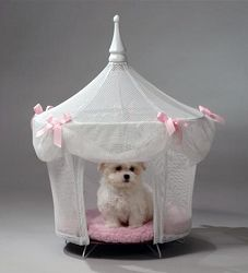 Dog Beds to Adore! To really bring out your doggie diva's inner princess, the Sugarplum Princess Dog Bed — White & Pink ($139.95) is a fantastic choice. The sheer white with pink bow accents form a luxurious tent over the soft, pink bedding below with a matching pink pillow. Made from high quality materials with craftsmanship you can count on, these dog tent beds are made to last. The diameter of the bed is 21 inches and it is 29 inches tall. Similar to the princess dog bed above, the Pretty...