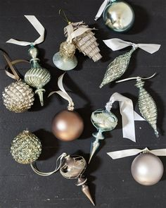 This ornaments collection features intricately hand-painted blown glass ornaments in the stunning colors of frost blue, champagne, and platinum.