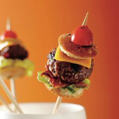"100 Things You Can Serve On A Stick ""Does it get any cuter, more Pinteresting, or cocktail-friendly than cake pops, kabobs, and popsicles?"" Pictured: burger on a stick"
