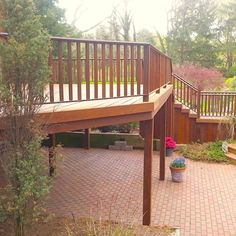 Second Story Pre-Oiled Ipe Deck installed with hidden clips with IPE railings.  Storage cabinet under stairs and IPE wrapped columns.  Project was in Muttontown, NY.