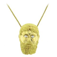 Henry Dunay Massive Diamond Gold Face Pendant Brooch  | From a unique collection of vintage necklace enhancers at https://www.1stdibs.com/jewelry/necklaces/necklace-enhancers/